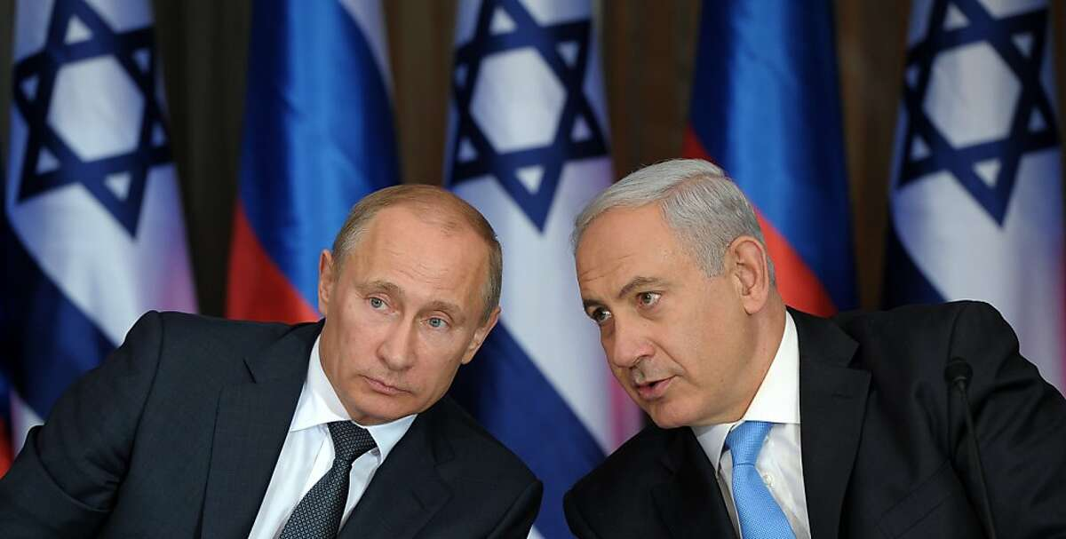 Russian President Vladimir Putin, left, and Israeli Prime Minister Benjamin Netanyahu speak to the media after their meeting and a lunch in the Israeli leader's Jerusalem residence, Monday, June 25, 2012. Netanyahu says Russian President Vladimir Putin agrees that a nuclear Iran would pose a