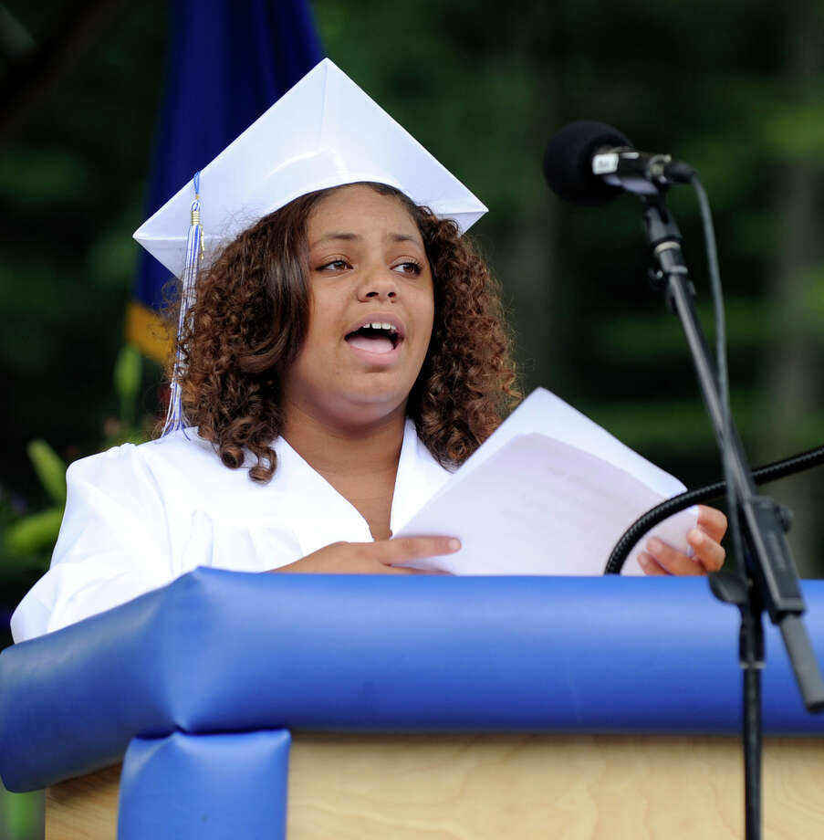 Lillian Rosado sings the National Anthem at the Henry Abbott Tech graduation ceremony held at the Ives Concert Park at Western Connecticut State University Monday, June 25, 2012. Photo: Carol Kaliff / The News-Times