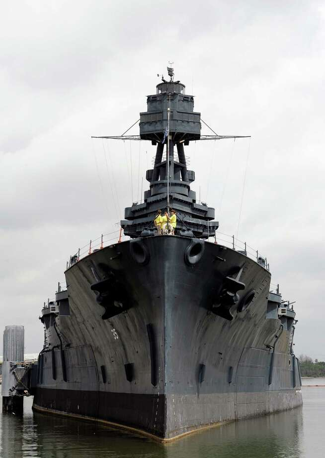In this June 13, 2012 file photo, tourists visit the deck of the USS Battleship Texas as she lists slightly on the port side, in Houston. The 100-year-old museum is closed indefinitely after several leaks flooded the vessel that fought in World Wars I and II. Photo: AP