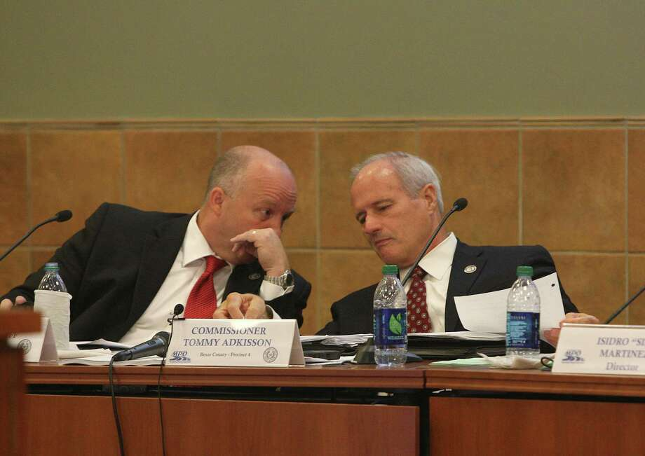 If county Commissioners,  including Kevin Wolff and Tommy Adkisson (shown at an MPO meeting last month), want efficiency, then they should consider merging RMA and VIA. Photo: Julysa Sosa, San Antonio Express-News / © 2012 San Antonio Express-News