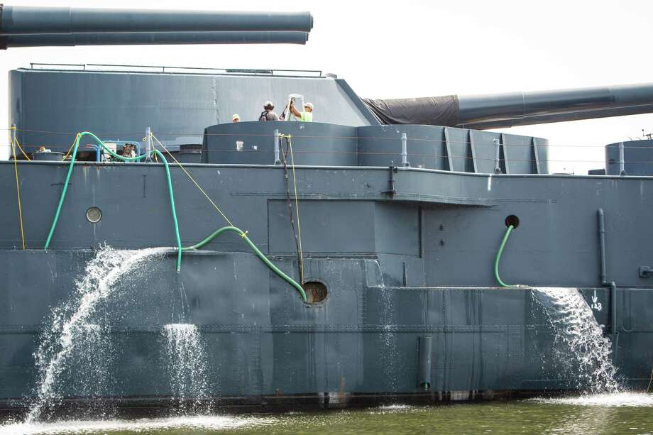 Pumps remove water from the Battleship Texas on Monday. Photo: Michael Paulsen, Houston Chronicle / © 2012 Houston Chronicle