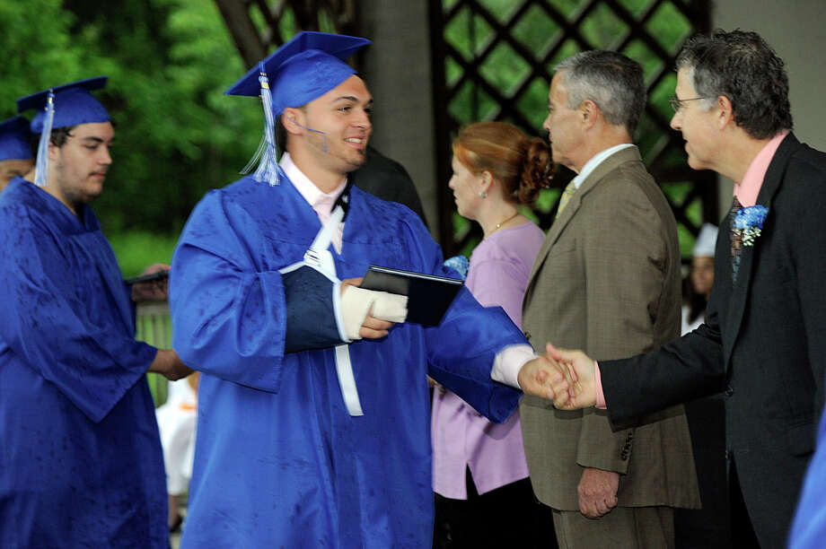 Henry Abbott Tech held its graduation ceremony at the Ives Concert Park at Western Connecticut State University Monday, June 25, 2012. Photo: Carol Kaliff