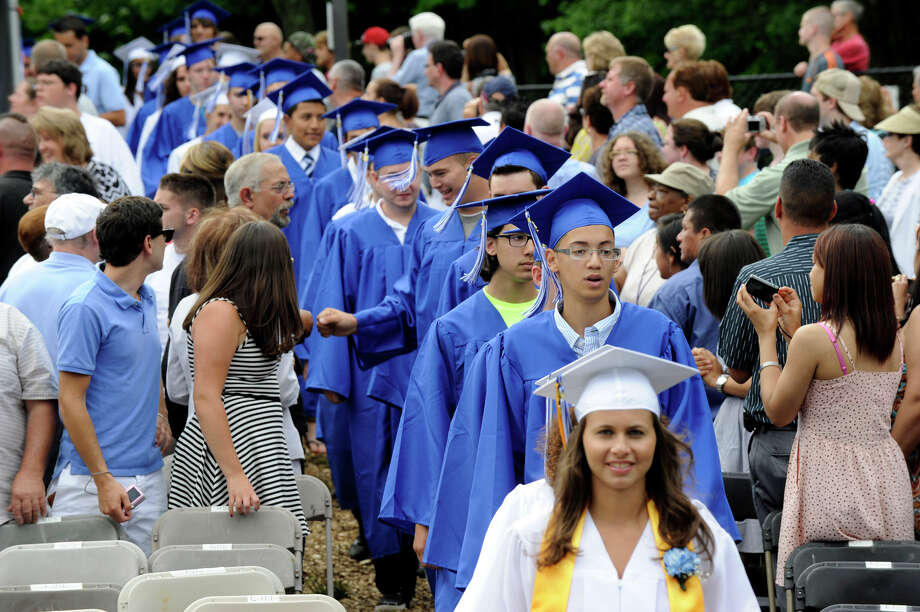 Henry Abbott Tech held its graduation ceremony at the Ives Concert Park at Western Connecticut State University Monday, June 25, 2012. Photo: Carol Kaliff / The News-Times