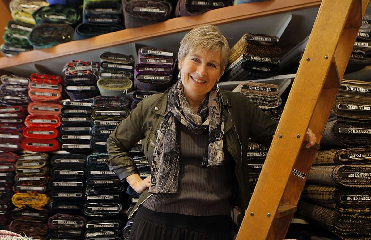 """Sharman Spector poses for a picture at the 60 years old store Britex Fabrics she owns in San Francisco, CA on May 4, 2012. The family shop opened in 1952 by her parents Polish immigrants Martin and Lucy Spector. Many of the store employees had worked for the company for many years including Melody Doss, who has been with Britex for 33 years, """"Button Lady,"""" Maya Gorokhovskaya and Douglas Davis has been here for 23 years."""