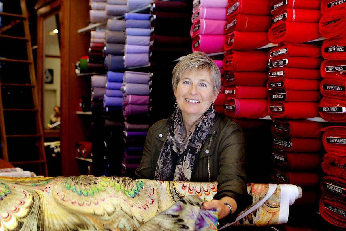 Sharman Spector shows a colorful fabric as she is photographed at the 60 years old store Britex Fabrics she owns in San Francisco, CA on May 4, 2012. The family shop opened in 1952 by her parents Polish immigrants Martin and Lucy Spector.