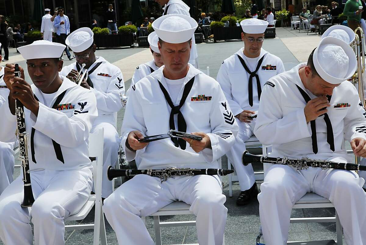 Members of the Navy Region Southwest Band are preparing to play at the Dewey Monument Commemoration Ceremony at Union Square in San Francisco, Calif. on Monday, June 25, 2012.