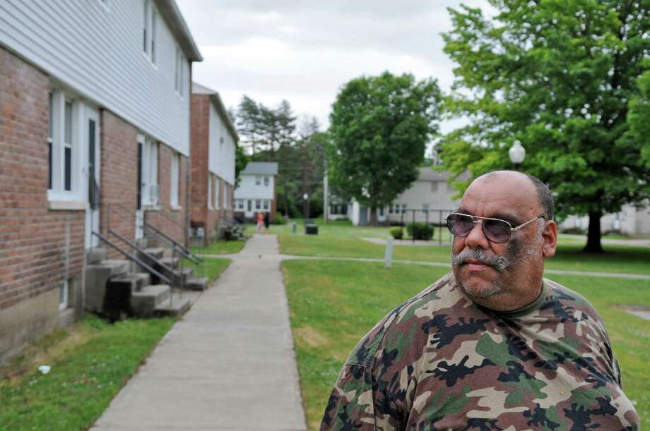 Peter Berrios, Jr. says that loitering and noise, among other problems, have increased at Jefferson Terrace, where he lives,  since the Saratoga Springs police stopped assigning an officer to housing authority properties due to departmental cuts, on Monday June 25, 2012 in Saratoga Springs, NY.  (Philip Kamrass / Times Union) Photo: Philip Kamrass / 00018235A