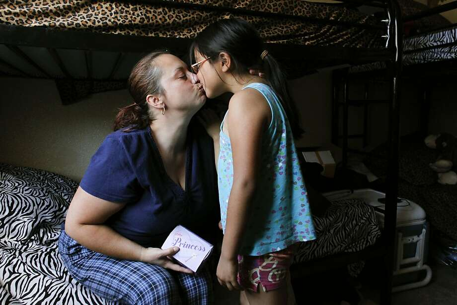 Elizabeth Cerna, 7 gets a kiss from her mom Michelle on Monday June 25, 2012, in Stockton, Calif. The kiss came after Elizabeth who has been saving coins, a total of 37 cents, she finds and then keeps in a small Princess box, said she was going to use the money to help buy a house. The Cerna family is staying at the Stockton Shelter for the Homeless until Michelle's boyfriend can earn enough money to move out into a place of their own.  Stockton, is expected to become the biggest city in American history to file for bankruptcy. Photo: Michael Macor, The Chronicle