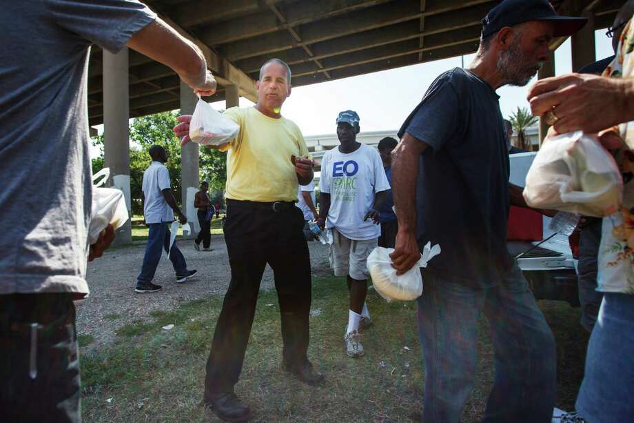 Noah's Kitchen had been feeding the homeless in Houston for years, but recently decided to quit because of requirements in a new municipal ordinance. Photo: Michael Paulsen / © 2012 Houston Chronicle