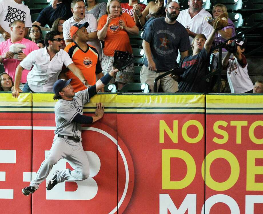 San Diego Padres right fielder Chris Denorfia goes high on the wall but can't reach the ball on a solo home run by Houston Astros' Brian Bixler in the first inning of a baseball game Monday, June 25, 2012, in Houston. Photo: AP