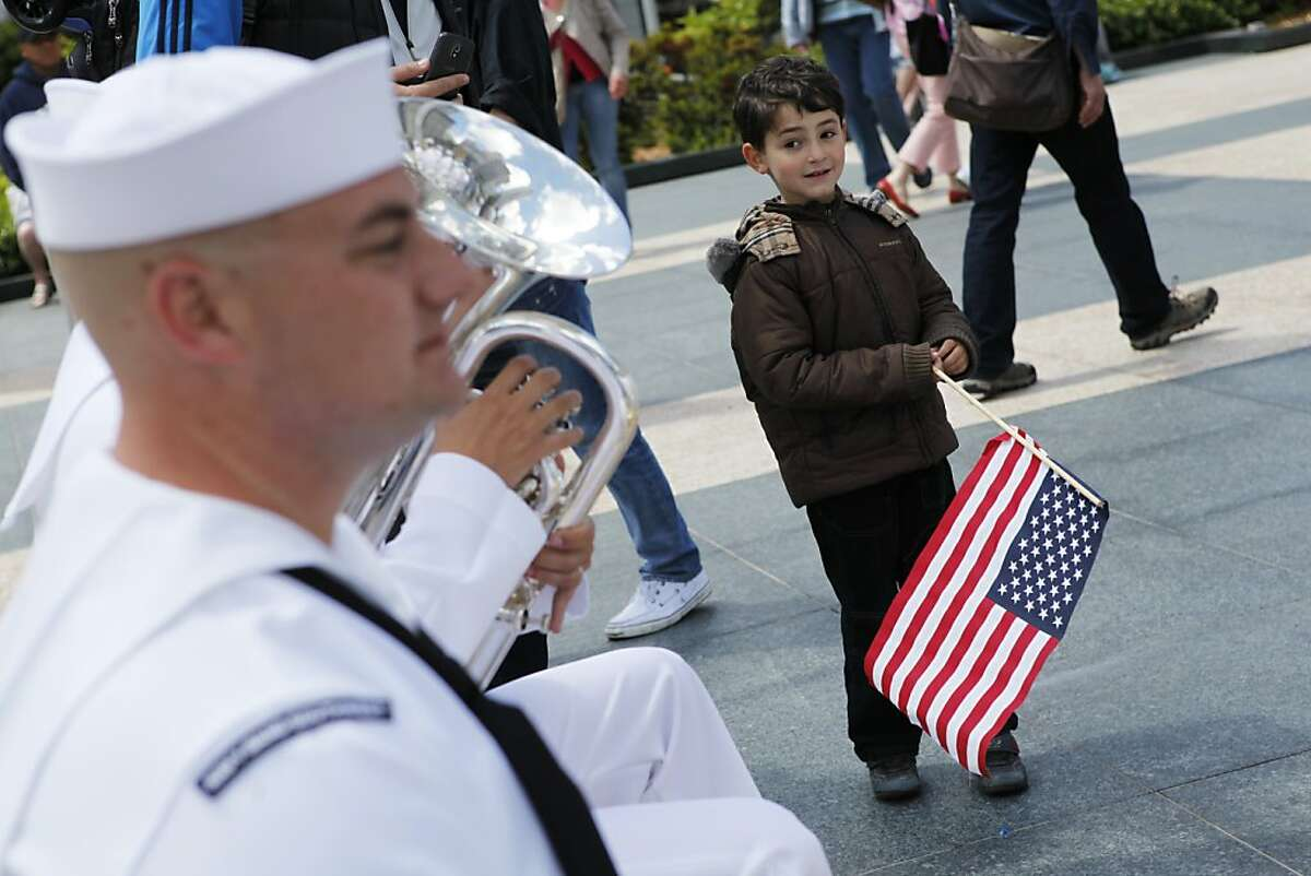 Austin Polonsky,5, watches the Navy Region Southwest Band during the Dewey Monument Commemoration Ceremony at Union Square in San Francisco, Calif. on Monday, June 25, 2012.