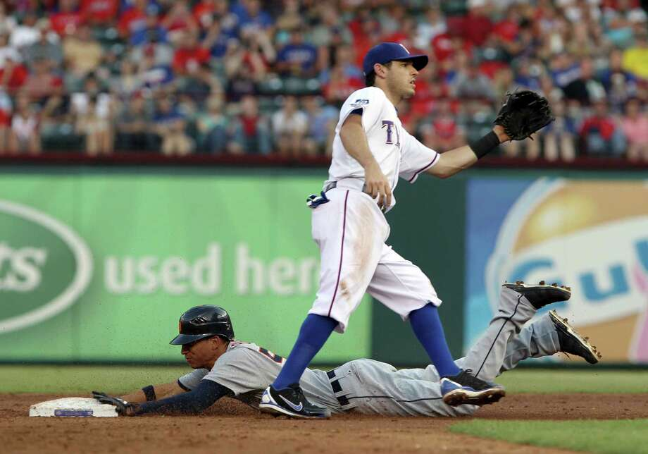 Detroit Tigers' Quintin Berry (52) steals second as Texas Rangers second baseman Ian Kinsler waits for the throw in the second inning of a baseball game in Arlington, Texas, Monday, June 25, 2012. Photo: AP
