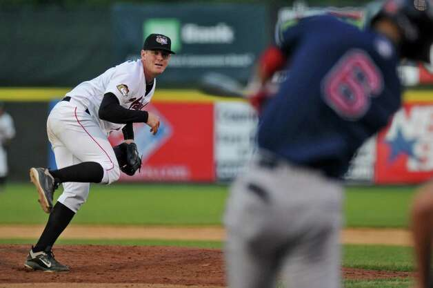 Tri-City ValleyCats Aaron West pitches to Lowell Spinners player Deven Marrero during a game on Monday night June 25, 2012 in Troy, NY.(Philip Kamrass / Times Union) Photo: Philip Kamrass / 00018017A