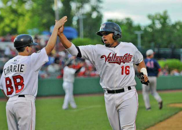 Tri-City ValleyCats Jobduan Morales celebrates after crossing home to make the score 4-0 in the bottom of the fourth inning, during a game against the  Lowell Spinners on Monday night June 25, 2012 in Troy, NY.(Philip Kamrass / Times Union) Photo: Philip Kamrass / 00018017A