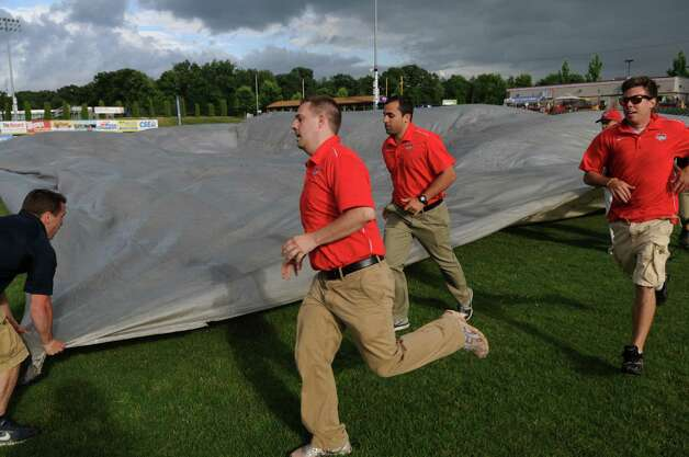 The tarp went on the field temporarily after a brief rain before the start of the Tri-City ValleyCats game against the  Lowell Spinners on Monday night June 25, 2012 in Troy, NY.(Philip Kamrass / Times Union) Photo: Philip Kamrass / 00018017A