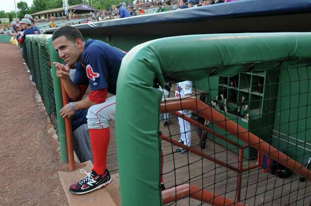 Lowell Spinners player Deven Marrero, the 2012 first round draft pick of the Boston Red Sox, gestures towards the Tri-City ValleyCats dugout during introductions before a game on Monday night June 25, 2012 in Troy, NY. (Philip Kamrass / Times Union) Photo: Philip Kamrass / 00017807A