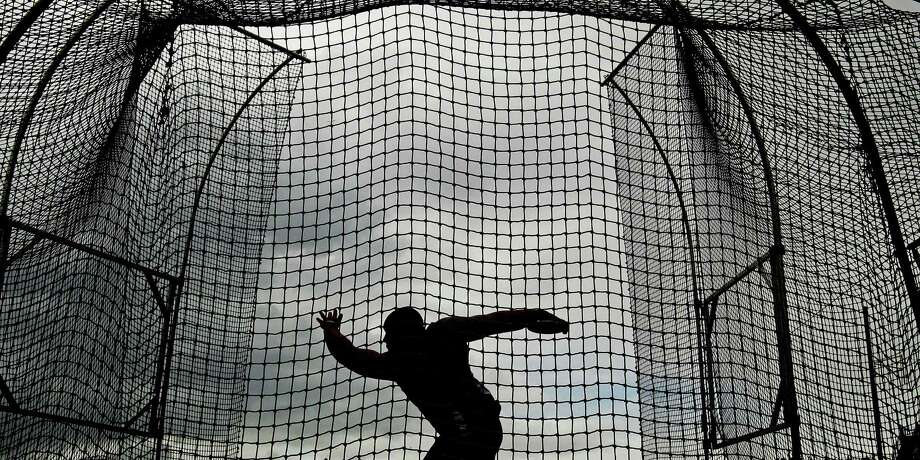 Bryan Powlen Jr., throws during a qualifying round for the men's discus at the U.S. Olympic Track and Field Trials Monday, June 25, 2012, in Eugene, Ore. Photo: Charlie Riedel, Associated Press / AP