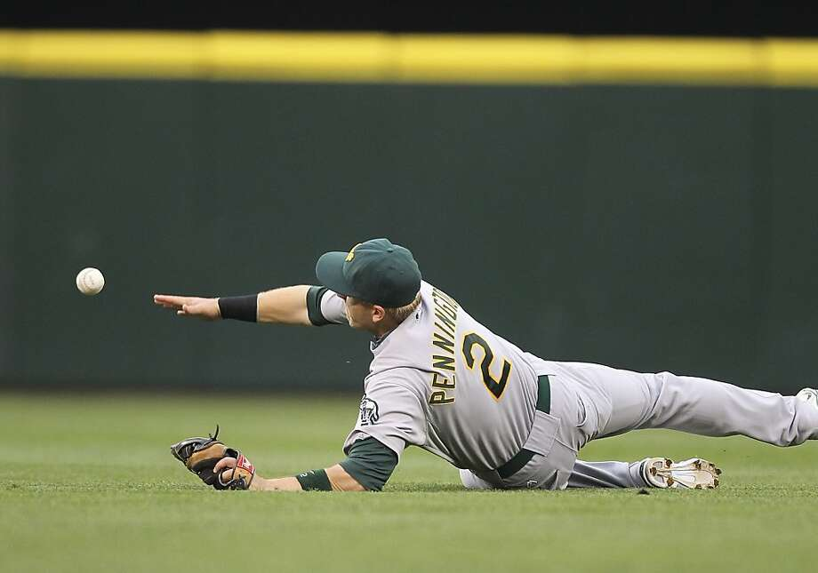 Shortstop Cliff Pennington dives for a single at Safeco Field on Monday. Photo: Otto Greule Jr, Getty Images