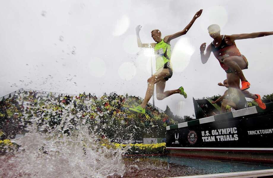 Runners clear a water jump during a men's 3,000m steeplechase preliminary at the U.S. Olympic Track and Field Trials Monday, June 25, 2012, in Eugene, Ore. (AP Photo/Matt Slocum) Photo: Matt Slocum, Associated Press / AP