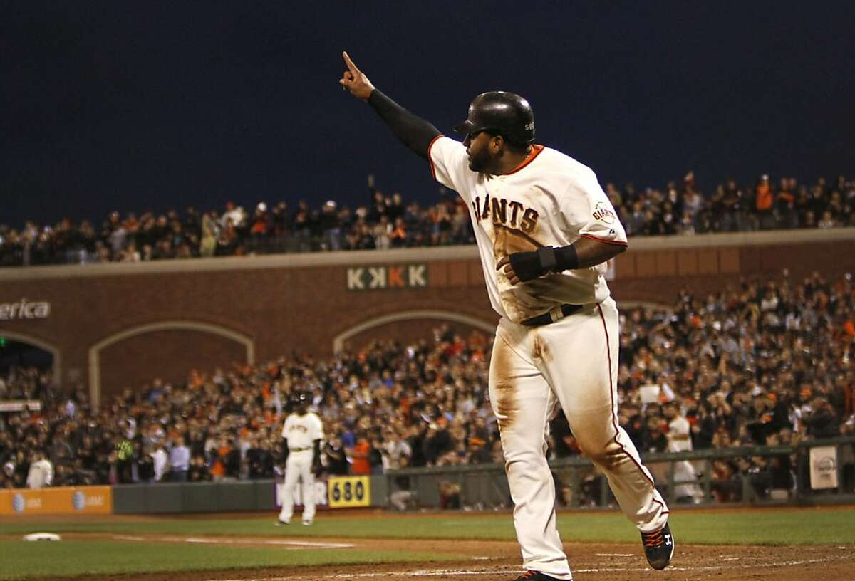 San Francisco Giants Pablo Sandoval signals to the crowd after he doubled in the fifth inning against the Los Angeles Dodgers in San Francisco, Calif., Monday, June 25, 2012.