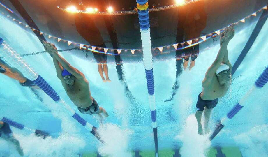 Ryan Lochte, left, and Michael Phelps swim in the men's 400-meter individual medley final at the U.S. Olympic swimming trials, Monday, June 25, 2012, in Omaha, Neb. Photo: David Phillip, Associated Press / Copyright 2012 The Associated Press. All rights reserved. This material may not be published, broadcast, rewritten or redistribu