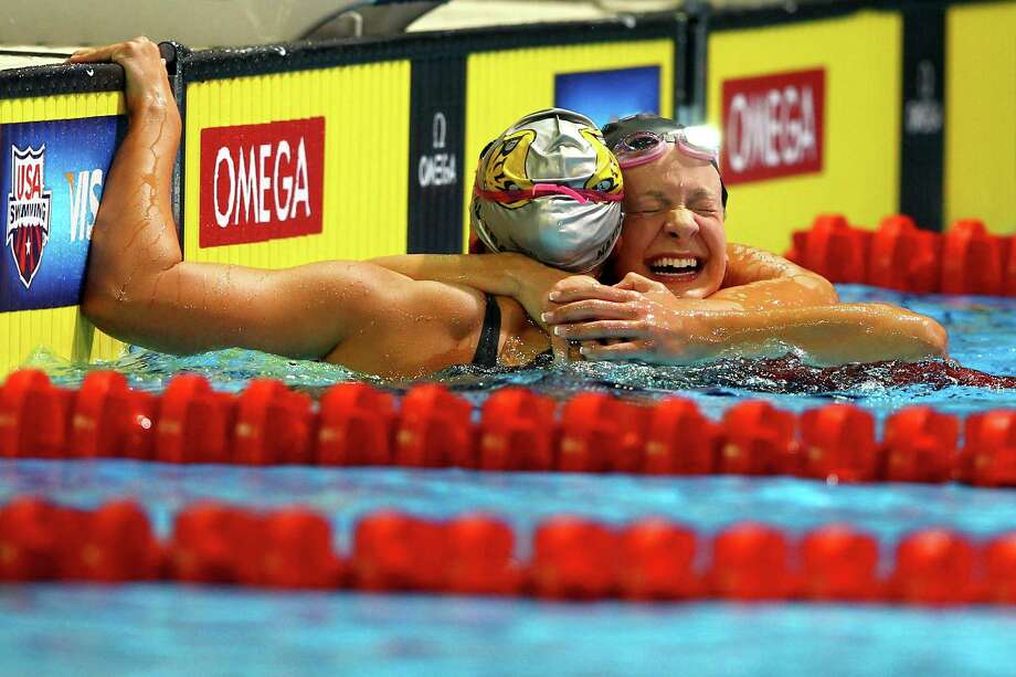 Meghan Hawthorne and Andrea Kropp react after they swam in the preliminary heat of the Women's 400 m Individual Medley during the 2012 U.S. Olympic Swimming Team Trials at CenturyLink Center on June 25, 2012 in Omaha, Nebraska. Photo: Al Bello, Getty Images / 2012 Getty Images