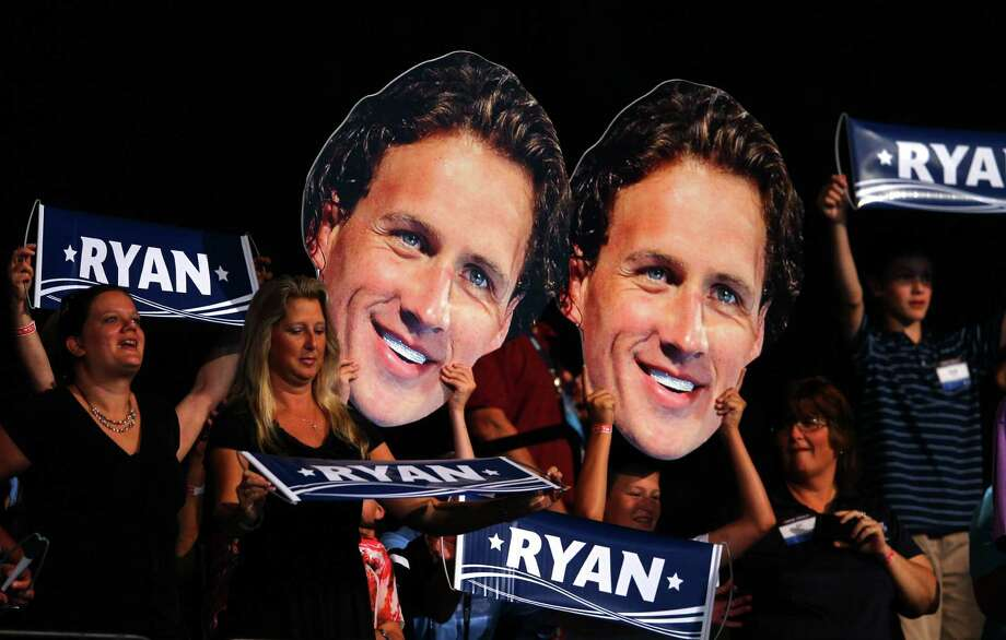 Fans hold up giant cardboard cutouts with the likeness of Ryan Lochte on them in support of Lochte prior to him swimmimg in the championship final heat of the Men's 400 m Individual Medely during the 2012 U.S. Olympic Swimming Team Trials at CenturyLink Center on June 25, 2012 in Omaha, Nebraska. Photo: Al Bello, Getty Images / 2012 Getty Images