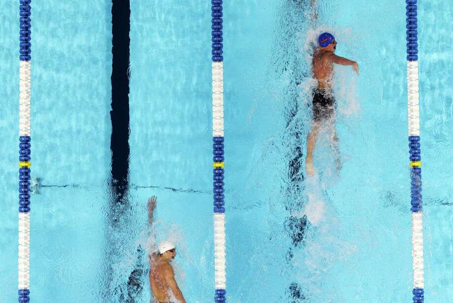 Ryan Lochte, right, leads Michael Phelps in the men's 400-meter individual medley final at the U.S. Olympic swimming trials, Monday, June 25, 2012, in Omaha, Neb.  Lochte won the race. Photo: Mark Humphrey, Associated Press / AP