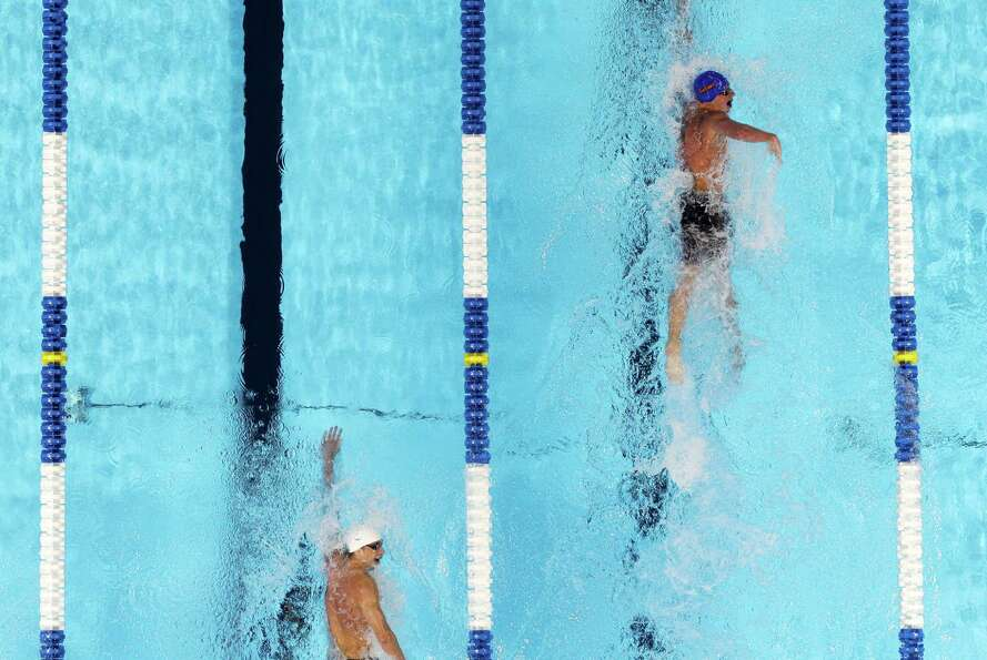 Ryan Lochte, right, leads Michael Phelps in the men's 400-meter individual medley final at the U.S.