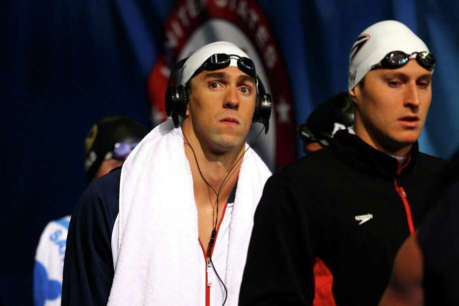 Michael Phelps looks on as he walks onto the deck to compete in preliminary heat 10 of the Men's 400 m Individual Medley during the 2012 U.S. Olympic Swimming Team Trials at CenturyLink Center on June 25, 2012 in Omaha, Nebraska. Photo: Al Bello, Getty Images / 2012 Getty Images