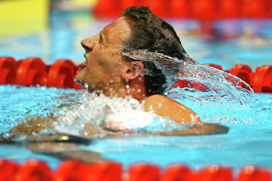 Ryan Lochte shakes water out of his hair after he competed in preliminary heat 12 of the Men's 400 m Individual Medley during the 2012 U.S. Olympic Swimming Team Trials at CenturyLink Center on June 25, 2012 in Omaha, Nebraska. Photo: Al Bello, Getty Images / 2012 Getty Images