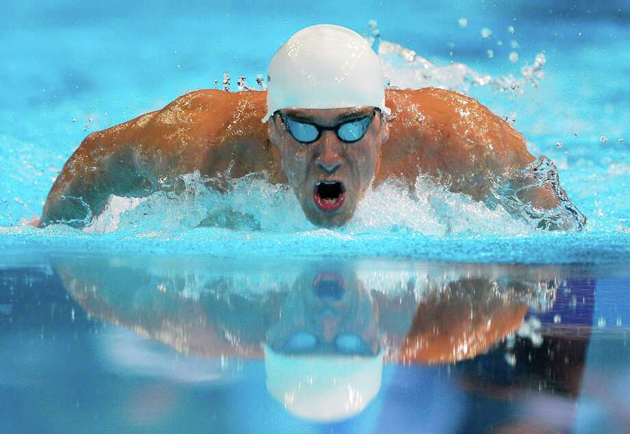 Michael Phelps swims in the men's 400-meter individual medley final at the U.S. Olympic swimming trials, Monday, June 25, 2012, in Omaha, Neb. Photo: Mark J. Terrill, Associated Press / AP