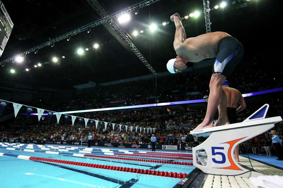 Michael Phelps stretches on the block prior to the start of the championship final heat of the Men's 400 m Individual Medely during the 2012 U.S. Olympic Swimming Team Trials at CenturyLink Center on June 25, 2012 in Omaha, Nebraska. Photo: Jamie Squire, Getty Images / 2012 Getty Images