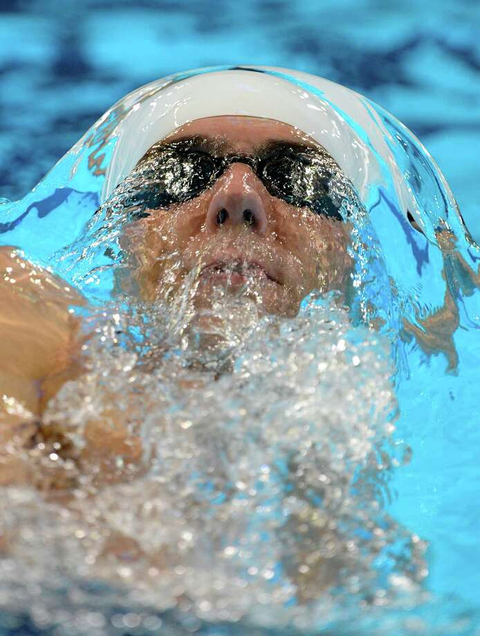 Michael Phelps swims in the men's 400-meter individual medley preliminaries at the U.S. Olympic swimming trials, Monday, June 25, 2012, in Omaha, Neb. Photo: Mark J. Terrill, Associated Press / AP