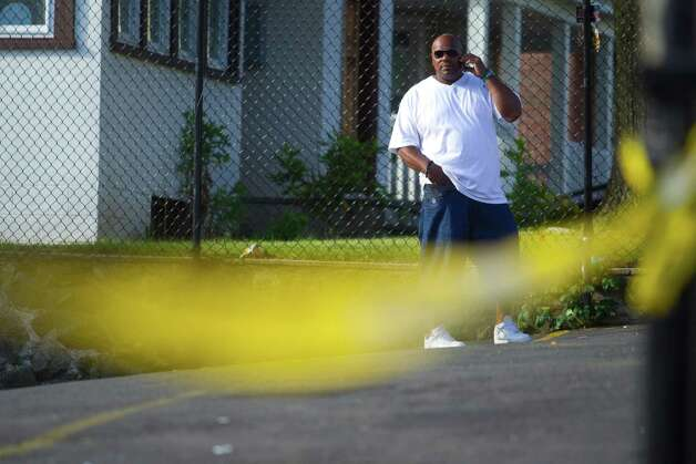 Rufus Ford talks on the phone as Stamford Police investigate the homicide of a man friends identified as James Decrescenzo inside Uncle Buck's Laundromat at the intersection of Stillwater and Fairfield Avenues on the city's west side on Tuesday, June 26, 2012. Photo: Chris Preovolos / Stamford Advocate