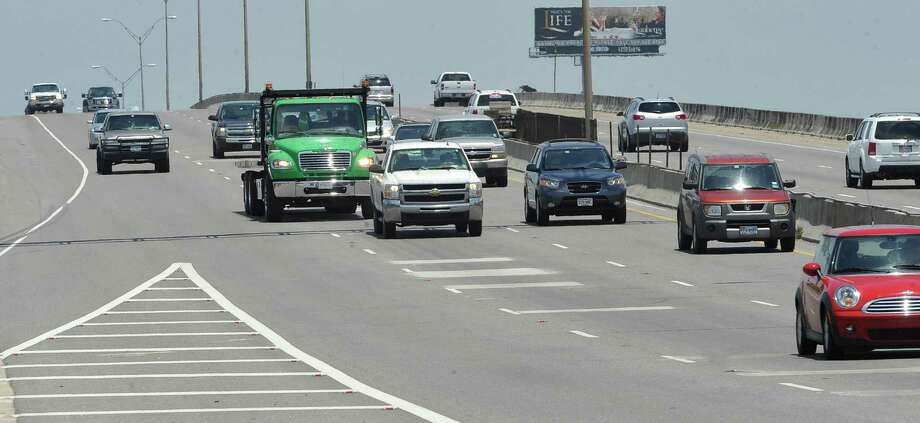 The Neches River Bridge, also known as the Purple Heart Memorial Bridge, had the flow of traffic back to normal Monday afternoon, June 25, 2012.  Dave Ryan/The Enterprise Photo: Dave Ryan