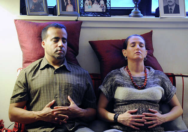 Expecting parents, Ruben and Kate Mercado of New Rochelle, N.Y., learn HypnoBirthing at the Stamford home of Muneeza Ahmed, Tuesday night, June 19, 2012. Photo: Bob Luckey / Greenwich Time