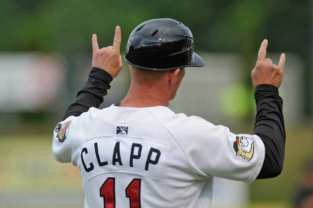 Tri-City ValleyCats manager Stubby Clapp signals to a baserunner during their game with the Lowell Spinners on Monday night June 25, 2012 in Troy, NY. (Philip Kamrass / Times Union) Photo: Philip Kamrass / 00018017A
