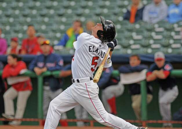 Tri-City ValleyCats Austin Elkins pops one up during their game with the Lowell Spinners on Monday night June 25, 2012 in Troy, NY. (Philip Kamrass / Times Union) Photo: Philip Kamrass / 00018017A