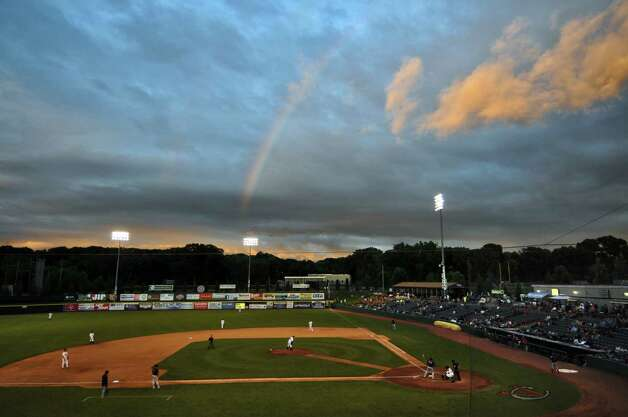 A rainbow makes an appearance over Joseph Bruno Stadium as Tri-City ValleyCats pitcher Thomas Shirley prepares to deliver a pitch to Oscar Perez during a game against the Lowell Spinners on Monday night June 25, 2012 in Troy, NY.(Philip Kamrass / Times Union) Photo: Philip  Kamrass / 00018017A