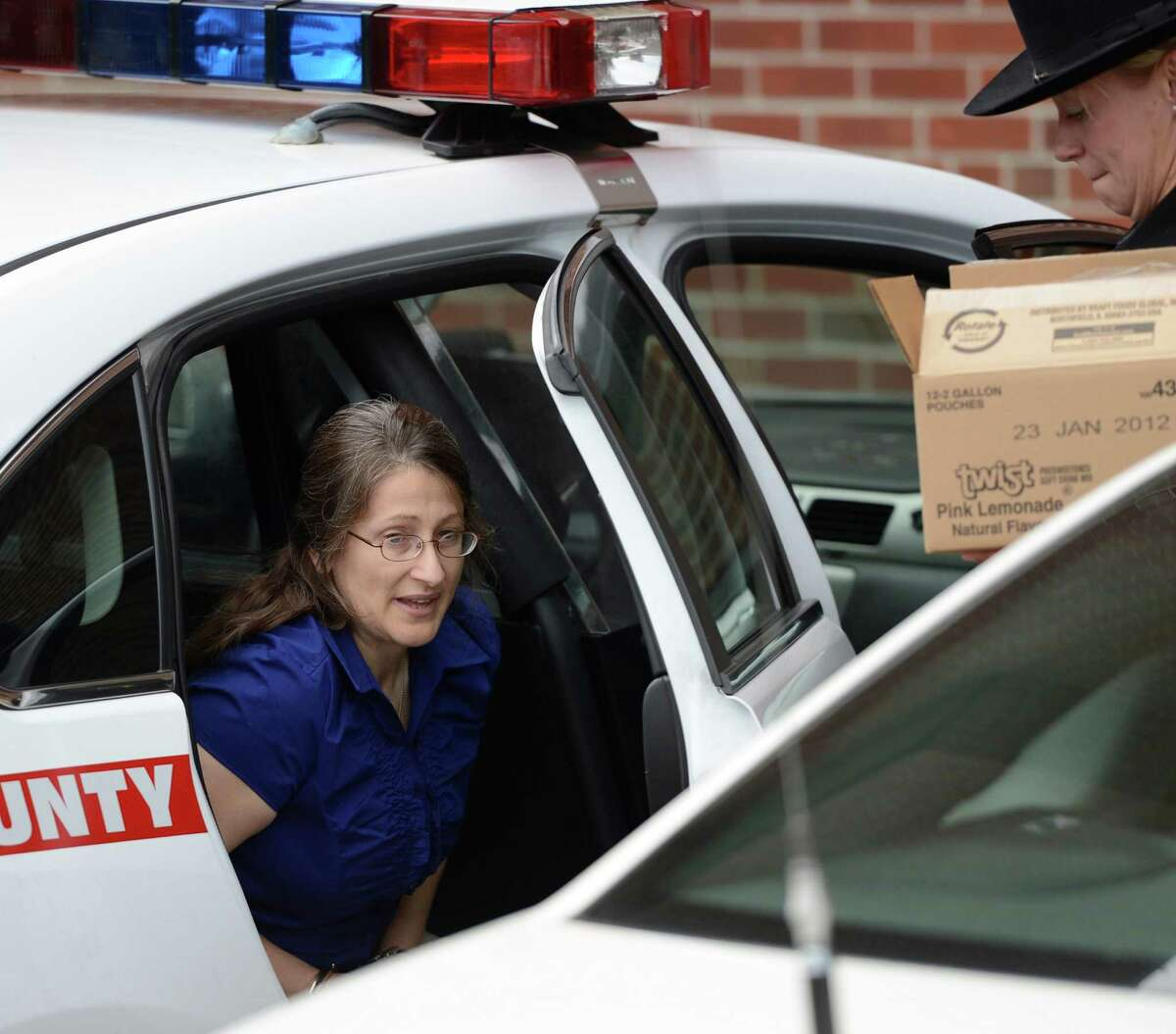 Lydia Salce, 50 exits a Sheriff's cruiser before she enters the Saratoga County Courthouse in Ballston Spa, N.Y. June 26, 2012 for opening arguments in her attempted murder trial where she is charged with allegedly stabbing her husband more than a dozen times during a domestic dispute last summer. (Skip Dickstein / Times Union)