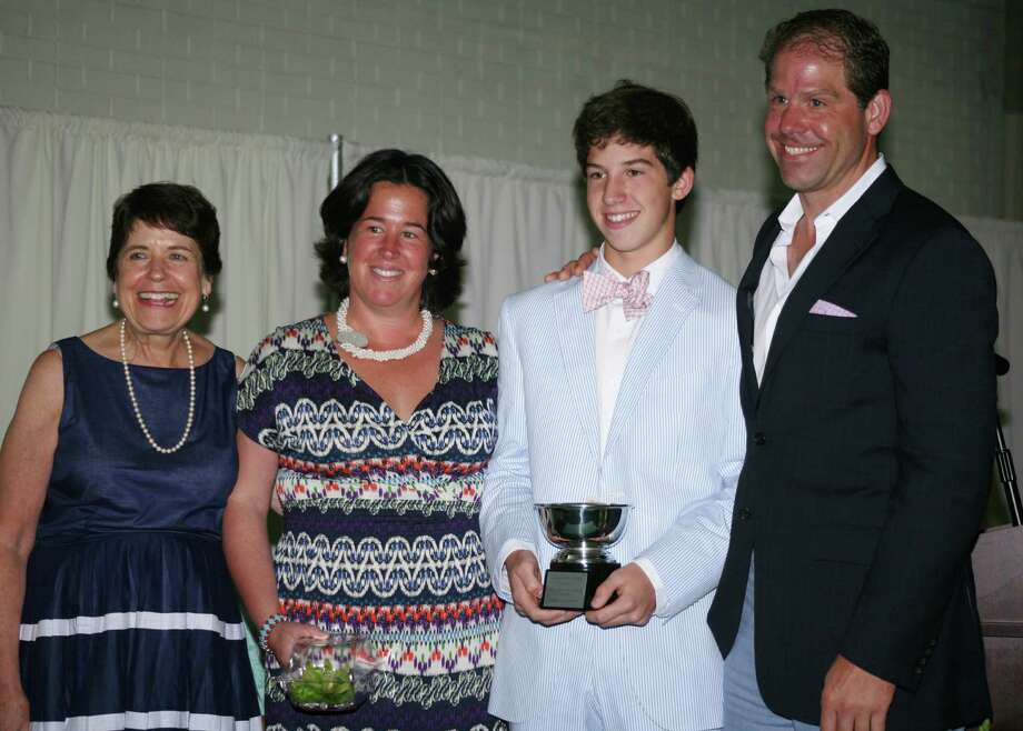 Burke Hilder, winner of the Eagle Hill School Head of School Trophy, poses with, from left, Head of School Dr. Marjorie E. Castro, mother and Board of Trustee member Katie Kidder (Darien, Conn.), and father Ted Hilder (Rowayton, Conn.). Photo: Contributed Photo