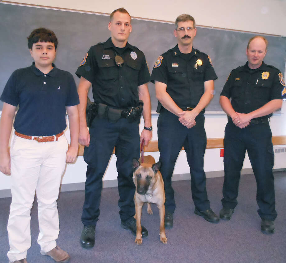 Gathered Monday at welcoming ceremony for the Westport Police Department's new K9 service dog, Koda, are from left: Michael Cantor, who suggested Koda's name; Officer James Loomer, the dog's handler; Chief Dale Call, and Sgt. Ryan Paulsson. Photo: Mike Lauterborn / Westport News contributed