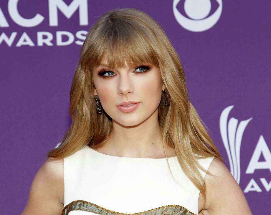 "FILE - This April 1, 2012 file photo shows country singer Taylor Swift at the 47th Annual Academy of Country Music Awards in Las Vegas. Swift's ""The Hunger Games"" soundtrack entry ""Safe & Sound"" with The Civil Wars _ a duo happily adopted by Swift's fan base _ also is nominated for video of the year for the 2012 CMT Awards, which kicks off at 8 p.m. EDT Wednesday, June 6, from Nashville's Bridgestone Arena.. (AP Photo/Isaac Brekken) Photo: Isaac Brekken / 2012 AP"