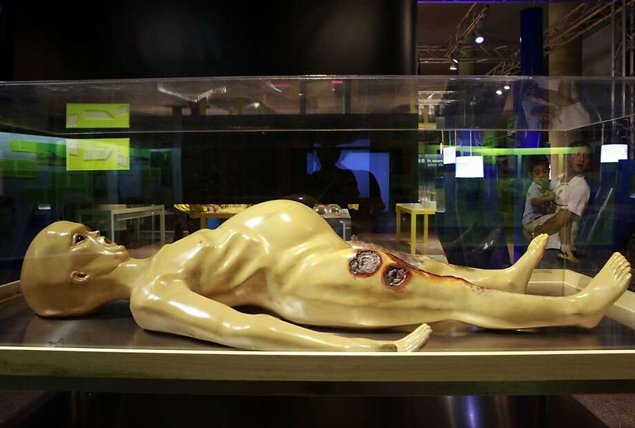 Alert Scully and Mulder:A Beijing exhibition depicting what aliens may look like shows an injured exterrestrial who is either pregnant or just competed in Wing Bowl. Photo: Ng Han Guan, Associated Press