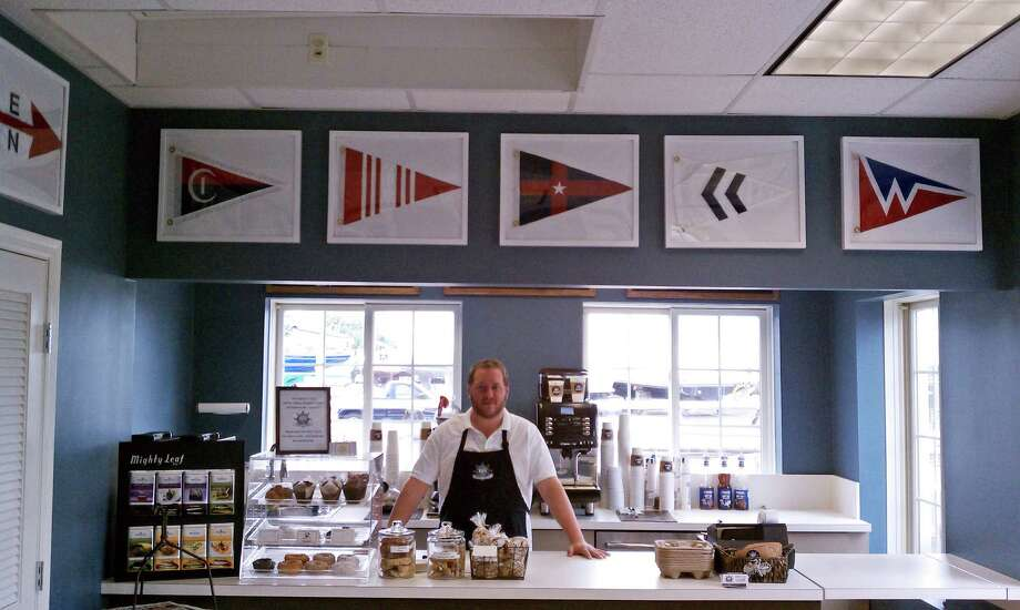 Neil Ward, manager of the new Captain's Cup coffee shop at  Norwalk Cove Marina, awaits patrons.  He is a fourth-generation member of the Gardella family, owners of the marina. Photo: Contributed Photo