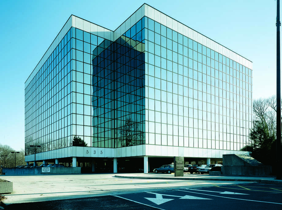 The new owners of 535 Connecticut Ave., in Norwalk, Conn. are starting to see their office building fill up. Anchored by the University of Phoenix, the complex will add OperationsInc, a human resources outsourcing firm, in August 2012. Photo: Contributed Photo / Stamford Advocate Contributed