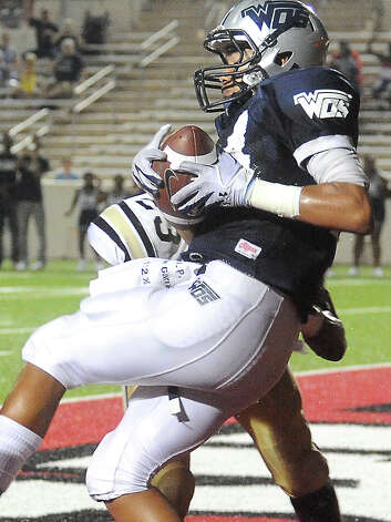 WOS's J'Marcus Rhodes catches a touchdown pass during the game against Nederland at the Provost Umphrey Stadium at Lamar University in Beaumont, Friday. Tammy McKinley/The Enterprise Photo: TAMMY MCKINLEY