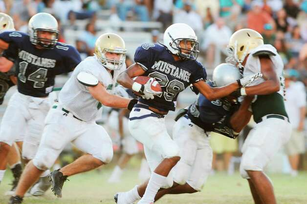 WO-S running back Bubba Tezeno rushes against the Little Cypress-Mauriceville defense during thier scrimmage at West Orange-Stark Middle School. Friday,  August 12, 2011 Valentino Mauricio/The Enterprise