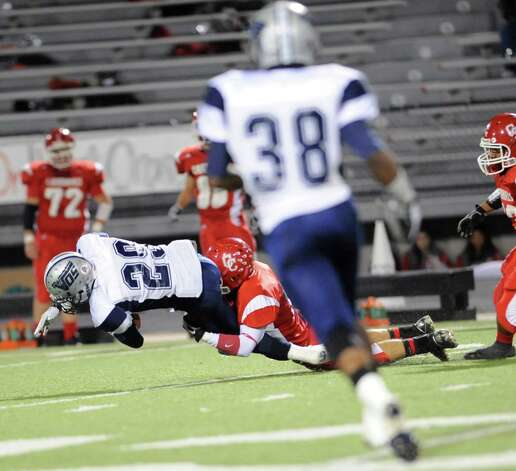 West Orange-Stark Mustang #29, Quinton Tezeno, is brought down after running for the first down in first half action against the Columbus Cardinals at Moorehead Stadium in Conroe Texas.  Dave Ryan/The Enterprise Photo: Dave Ryan
